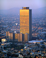 aerial photograph of the PEMEX Petróleos Mexicanos headquarters tower, Mexico City at sunset
