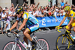 Lance Armstrong, riding his Damien Hirst custom bike, and Alberto Contador, Tour de France 2009, on the circuit of the Champs Elysees and Rue de Rivoli in Paris