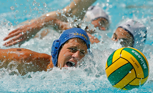 Kearns,UT--5/20/06--2:42:42 PM-.Kearns' Adam Huff, #8, battles for possession of the ball against Skyline's during the second half of the game..**.Skyline v Kearns men's Water Polo Championships. Kearns won 8-4...Chris Detrick/Salt Lake Tribune.File #_2CD4154..