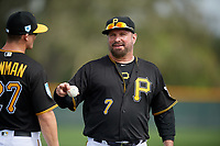 Pittsburgh Pirates Garth Brooks (7) jokes with Kevin Newman (27) during the teams first Spring Training practice on February 18, 2019 at Pirate City in Bradenton, Florida.  (Mike Janes/Four Seam Images)