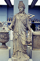 Greek Art:  Isis, Roman--120-150 A.D.  Right hand has been restored as Goddess Ceres holding  ears of corn, poppy head and date.  Left hand hold pail carried in procession of worshipers of Isis.  British Museum.