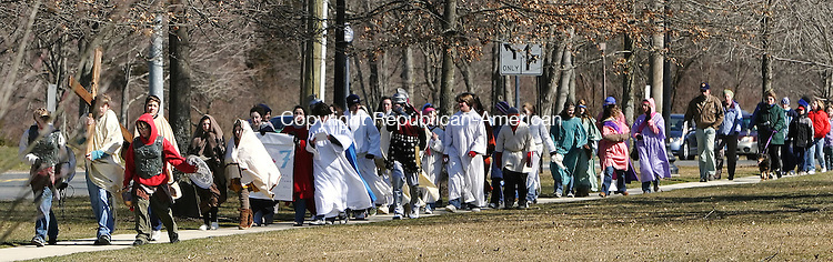 SOUTHBURY, CT 03/21/08- 032108BZ01- More than 400 people participated in the annual Good Friday Faith Walk in Southbury.  The procession walked along Main Street South reenacting the stations of the cross along the way to Sacred Heart Church.<br /> Jamison C. Bazinet Republican-American