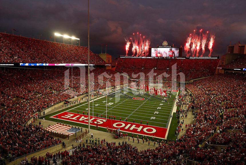 Fireworks announce the arrival of the Ohio State Buckeyes on the field before Saturday's NCAA Division I football game against the Virginia Tech Hokies at Ohio Stadium in Columbus on September 6, 2014. Virginia Tech led at halftime, 21-7. (Dispatch Photo by Barbara J. Perenic)