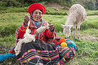 Quechua woman works wool into yarn, Lima Peru, South America
