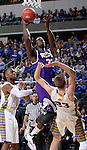 SIOUX FALLS, SD - MARCH 7: Jalen Chapman #33 of Western Illinois drives against Reed Tellinghuisen #23 of South Dakota State in the second half of the first round of the men's Summit League Championship Tournament game Saturday evening at the Denny Sanford Premier Center in Sioux Falls, SD.  (Photo by Dave Eggen/Inertia)