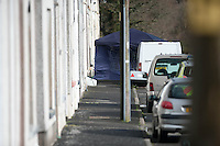 Tuesday 18 February 2014<br /> Pictured: Police forensic Activity at New road <br /> Re:A dog has been seized by police following the sudden death of a baby in Carmarthenshire.Officers say they had a call alerting them to the incident at a property in New Road, Pontyberem, shortly before 08:30 GMT on Tuesday.The baby was airlifted to the University Hospital of Wales, Cardiff, the Welsh Ambulance Service said.The dog involved in the incident was an Alaskan Malamute, similar to a Husky, which is not a banned breed.