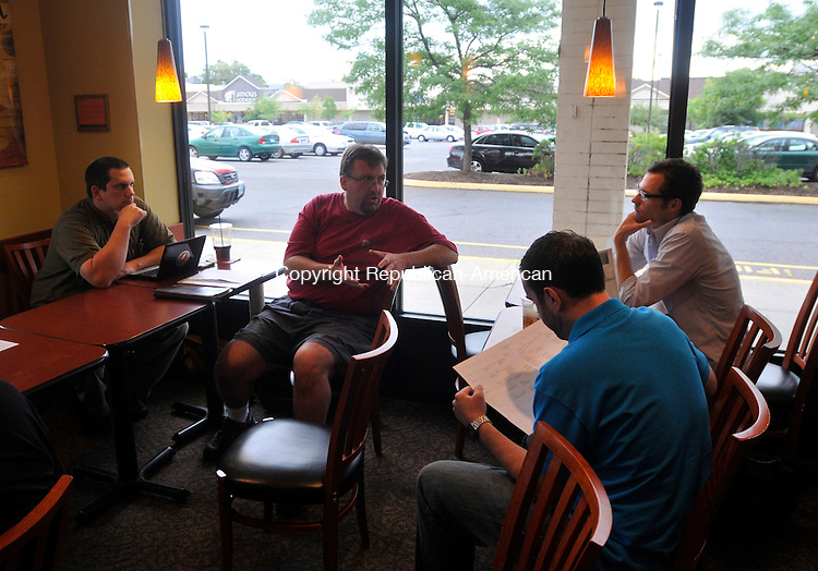 MERIDEN, CT-14 JULY 2010-071410IP05- (l to r) Jeff Myer of Middlebury, Bill Saturno of Waterbury,  Joe Rinaldi of Waterbury and Wil Koch of Madison talk during a meeting of local hackers at Panera Bread in Meriden on Wednesday.                                                                                                                                                                                                                                                                                                                                                                                                                                                                                                                                                                                                                                                                                                                                                                                                           <br /> Irena Pastorello Republican-American