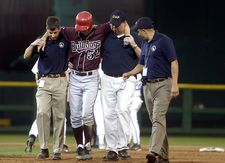Rep. Chip Pickering, R-Ms., is carried off the field after twisting his ankle at the 44th Annual Congressional Baseball Game at RFK stadium.