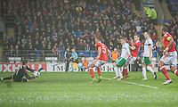 Sam Vokes of Wales sees his shot saved by Michael McGovern of Northern Ireland during the International Friendly match between Wales and Northern Ireland at Cardiff City Stadium, Cardiff, Wales on 24 March 2016. Photo by Mark  Hawkins / PRiME Media Images.