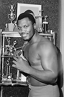 Nov 1st,1972. Former World Heavyweight American boxer Joe Frasier, nicknamed Smokin' Joe, posing with his numerous trophies. Among other things, Frazier is famous for his trilogy of fights with Muhammad Ali, of which their third bout, the Thrilla in Manila, has been considered by many to be boxing's greatest bout ever.