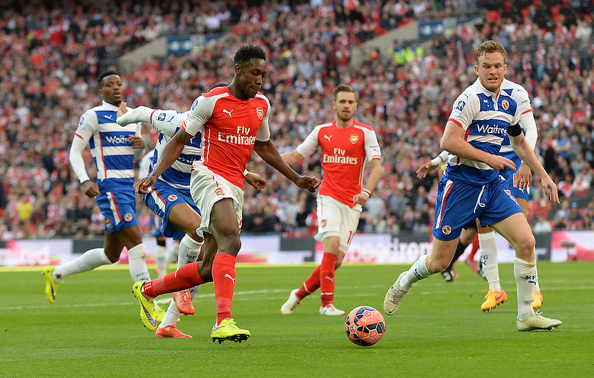 Arsenal's Aaron Ramsey shields the ball from \Reading's Michael Hector<br /> <br /> Photographer Ian Cook/CameraSport<br /> <br /> Football - The FA Cup Semi-Final - Reading v Arsenal - Saturday 18th April 2015 - Wembley - London<br /> <br /> &copy; CameraSport - 43 Linden Ave. Countesthorpe. Leicester. England. LE8 5PG - Tel: +44 (0) 116 277 4147 - admin@camerasport.com - www.camerasport.com