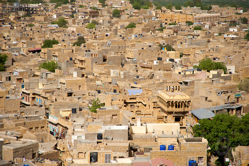 """Jaisalmer the old City and fort.J a i s a l m e r   J a i s a l m e r  n i c k n a m e d   """" T h e   G o l d e n   C i t y """" ,   i s   a   t o w n   i n   t h e   I n d i a n   s t a t e   o f   R a j a s t h a n .   T h e   t o w n   s t a n d s   o n   a   r i d g e   o f   y e l l o w i s h   s a n d s t o n e ,   c r o w n e d   b y   a   f o r t ,   w h i c h   c o n t a i n s   t h e   p a l a c e   a n d   s e v e r a l   o r n a t e   J a i n   t e m p l e s .   M a n y   o f   t h e   h o u s e s   a n d   t e m p l e s   a r e   f i n e l y   s c u l p t u r e d .   I t   l i e s   i n   t h e   h e a r t   o f   t h e   T h a r   D e s e r t   a n d   h a s   a   p o p u l a t i o n   o f   a b o u t   7 8 , 0 0 0 .   I t   i s   t h e   a d m i n i s t r a t i v e   h e a d q u a r t e r s   o f   J a i s a l m e r   D i s t r i c t ....Jaisalmer Fort is one of the largest of desert forts of the world. It is situated in Jaisalmer city in Indian state of Rajasthan. It was built in 1156 AD by the Bhati Rajput ruler Rawal Jaisal, from where it derives it name. The fort stands proudly admist the golden stretches of the great Thar Desert, on Trikuta Hill and had been the scene of many battles. Its massive yellow sandstone walls are a tawny lion color during the day, turning to a magical honey-gold as the sun sets and camouflages the fort making it appear a part of the picturesque yellow desert. Thus, it is also known as the """"Golden Fort"""".."""