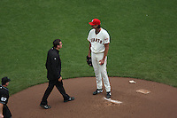 SAN FRANCISCO - JULY 5:  San Francisco Giants Head Athletic Trainer Dave Groeschner visits the mound to remove the injured Randy Johnson #51 of the San Francisco Giants from the game against the Houston Astros during the game at AT&T Park on July 5, 2009 in San Francisco, California. Photo by Brad Mangin