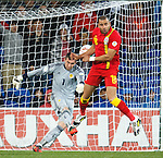 Allan McGregor boots the ball away from the onrushing Hal-Robson Kanu