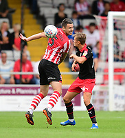 Lincoln City's Jason Shackell vies for possession with Swindon Town's Scott Twine<br /> <br /> Photographer Chris Vaughan/CameraSport<br /> <br /> The EFL Sky Bet League Two - Lincoln City v Swindon Town - Saturday 11th August 2018 - Sincil Bank - Lincoln<br /> <br /> World Copyright &copy; 2018 CameraSport. All rights reserved. 43 Linden Ave. Countesthorpe. Leicester. England. LE8 5PG - Tel: +44 (0) 116 277 4147 - admin@camerasport.com - www.camerasport.com