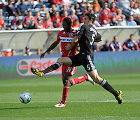 DC United defender Dejan Jakovic (5) attempts to tackle the ball away from Chicago Fire forward Patrick Nyarko (14).  The Chicago Fire tied DC United 0-0 at Toyota Park in Bridgeview, IL on Oct. 16, 2010.