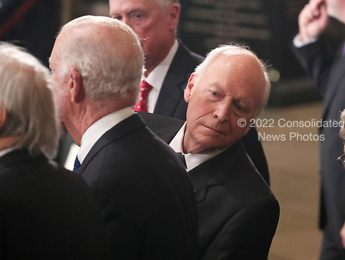 Former U.S. Vice President Dick Cheney looks behind former Secretary of State James Baker as he stands next to former Vice President Dan Quayle (rear) during memorial ceremonies for former President George H.W. Bush in the U.S. Capitol Rotunda in Washington, U.S., December 3, 2018. REUTERS/Jonathan Ernst/Pool