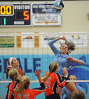 NWA Democrat-Gazette/ANDY SHUPE<br /> Jaden Williams (17) of Springdale Har-Ber sends the ball over the net past Hope Von Gremp (12) of Rogers Heritage Thursday, Sept. 17, 2015, at Wildcat Arena in Springdale. Visit nwadg.com/photos to see more photographs from the game.