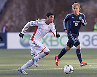 New England Revolution midfielder Lee Nguyen (24) at midfield.   In a Major League Soccer (MLS) match, Sporting Kansas City (blue) tied the New England Revolution (white), 0-0, at Gillette Stadium on March 23, 2013.