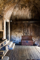 The restored kitchen in the palazzo features a vaulted ceiling and a rustic stove