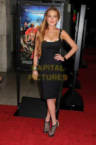 "Lindsay Lohan.Attending the ""Scary Movie 5"" Los Angeles film premiere held at the Cinerama Dome,  Hollywood, California, USA, .11th April 2013..full length dress black cleavage fishnet shoes plaits hair braids platform hand on hip gold cuff bracelet side tanned fake tan heels platform .CAP/ADM/BP.©Byron Purvis/AdMedia/Capital Pictures"