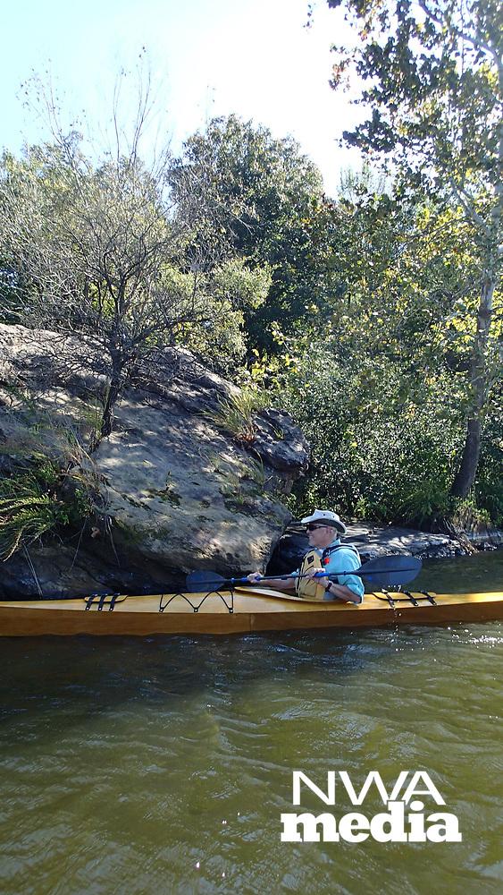 NWA Democrat-Gazette/FLIP PUTTHOFF<br />Warren Cunningham explores Oct. 13 2017 the rocky shores of Lincoln Lake in a kayak he built himself.