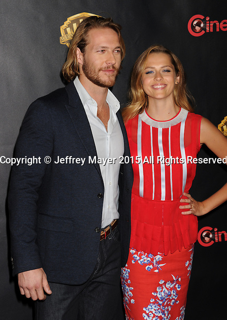 LAS VEGAS, CA - APRIL 21: Actors Luke Bracey (L) and Teresa Palmer arrive at Warner Bros. Pictures Invites You to ?The Big Picture at The Colosseum at Caesars Palace during CinemaCon, the official convention of the National Association of Theatre Owners, on April 21, 2015 in Las Vegas, Nevada.