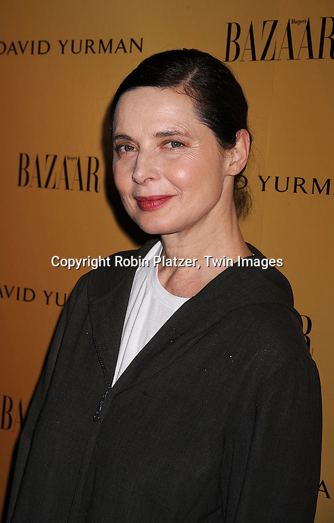 "Isabella Rossellini..posing for photographers at The Harper's Bazaar screening on April 29, 2008 of ""Everywhere At Once"",  a film from famed fashion photographer Peter Lindbergh and Holly Fisher. The event was at the Hearst Tower in New York City and was sponsored by David Yurman..Robin Platzer, Twin Images"