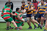 Galipo Misileki goes to ground after being hit in a hard tackle from William Furniss. Counties Manukau Premier Club Rugby game between Waiuku and Patumahoe, played at Waiuku on Saturday April 28th, 2018. Patumahoe won the game 18 - 12 after trailing 10 - 12 at halftime. <br /> Waiuku Brian James Contracting 12 - Apec Togafau, Nathan Millar tries, Christian Walker conversion.<br /> Patumahoe Troydon Patumahoe Hotel 18 - Vernon Comley, Riley Hohepa tries, Riley Hohepa conversion, Riley Hohepa 2 penalties.<br /> Photo by Richard Spranger
