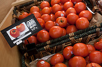 A tomato basket is seen in a Metro grocery store in Quebec city March 4, 2009. Selective focus on French labeled sign (tomate rouge).