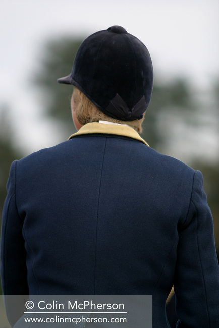 A woman with the Wynnstay Hunt wearing the hunt's traditional yellow collar, rides out to hunt foxes. The Wynnstay Hunt, named after Sir Watkin Williams-Wynn, dated back to the 18th century and hunted on country estates in Shropshire, Cheshire and north Wales. Hunting with dogs in England and Wales became illegal on 18th February 2005 despite legal challenges to the ban and many hunts vowed to continue the ancient sport of foxhunting, risking prosecution.