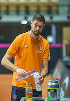 Arena Loire,  Trélazé,  France, 14 April, 2016, Semifinal FedCup, France-Netherlands, Dutch team warming up, Fysio Edwin Visser prepares his powerdrink<br /> Photo: Henk Koster/Tennisimages