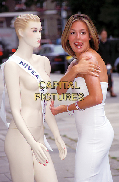 CAT DEELEY.white strapless dress, licking lips.Ref: 8715.www.capitalpictures.com.sales@capitalpictures.com.© Capital Pictures