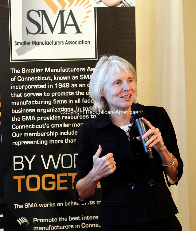 Watertown, CT- 15 September 2014-091514CM05- Department of Economic and Community Development Commissioner Catherine Smith gives a lecture during a Smaller Manufacturers Association's dinner meeting at the Watertown Country Club on Monday.  Christopher Massa Republican-American