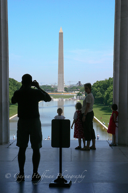 Family viewing the Washington Monument from the Lincoln Memorial. DC