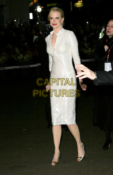 "NICOLE KIDMAN .UK Premiere of ""Australia"" at the Odeon, Leicester Square, London, UK, December 10th 2008..full length white sequined cream dress long sleeves open toe gold shoes christian louboutin buttons tunic .CAP/AH.©Adam Houghton/Capital Pictures"