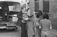 Moving equipment and books into the building, Scotland Road Free School, Liverpool  1971.  Also known as the Scotland Road or Scottie Road Free School it was founded and run by two teachers, John Ord and Bill Murphy (if I've got these names wrong, please tell me!) who worked with truanting kids and provided somewhere to go and things to do.  They begged and borrowed an old building, desks, books and an old ambulance for trips.