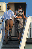 United States President Barack Obama and first lady Michelle Obama walk up Air Force One's stairs at Joint Base Pearl Harbor-Hickam, Honolulu, Hawaii, Monday, January 2, 2012.Credit: Cory Lum / Pool via CNP