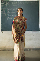 Varsha Karma, aged 28, stands for a portrait in her class in the Vasudha Vidya Vihar school in Khargone, Madhya Pradesh, India on 12 November 2014. Varsha teaches a variety of subjects to her 5 year-old students. Fairtrade farmers get a 5% discount on school fees because the school was built using the Fairtrade Premium. Photo by Suzanne Lee for Fairtrade