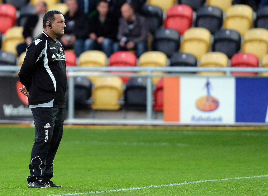 Edinburgh Rugby's Coach Michael Bradley watches as his team warms up ..Rugby Union - RaboDirect PRO12 - Newport-Gwent Dragons v Edinburgh Rugby - Friday 28th September 2012 -  Rodney Parade - Newport....