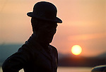 The bronze statue of Charlie Chaplain pictured against the setting sun in Waterville, Co. Kerry on Monday night when the annual Summer Splash festival weekend drew to a conclusion. Thousands of tourists flocked to the Kerry seaside village to soak up the sun or catch a glimpse of golfers Tiger Woods, Mark O'Meara, David Duval or Payne Stewart practising for this week's British Open at Carnoustie in the nearby golf links. The warm sunshne has seen increased tourist numbers to the county in what has been descirbed as a poor year so far for hotels and B&B's...Picture by Don MacMonagle