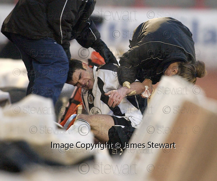 23/01/2005  Copyright Pic : James Stewart.File Name : jspa13_st mirren v airdrie.STUART KEAN SHOW HIS INJURIES AFTER BEING PUSHED OFF THE FIELD ON TO THE RED ASH AT THE SIDE OF THE PARK....Payments to :.James Stewart Photo Agency 19 Carronlea Drive, Falkirk. FK2 8DN      Vat Reg No. 607 6932 25.Office     : +44 (0)1324 570906     .Mobile   : +44 (0)7721 416997.Fax         : +44 (0)1324 570906.E-mail  :  jim@jspa.co.uk.If you require further information then contact Jim Stewart on any of the numbers above.........A