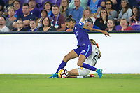 Orlando, FL - Saturday March 24, 2018: Orlando Pride defender Poliana Barbosa Medeiros (19) is challenged by Utah Royals forward Brittany Ratcliffe (25) during a regular season National Women's Soccer League (NWSL) match between the Orlando Pride and the Utah Royals FC at Orlando City Stadium. The game ended in a 1-1 draw.