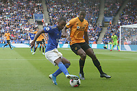 Leicester City's Ricardo Pereira and Wolverhampton Wanderers' Willy Boly <br /> <br /> <br /> <br /> Photographer Stephen White/CameraSport<br /> <br /> The Premier League - Leicester City v Wolverhampton Wanderers - Sunday 11th August 2019 - King Power Stadium - Leicester<br /> <br /> World Copyright © 2019 CameraSport. All rights reserved. 43 Linden Ave. Countesthorpe. Leicester. England. LE8 5PG - Tel: +44 (0) 116 277 4147 - admin@camerasport.com - www.camerasport.com