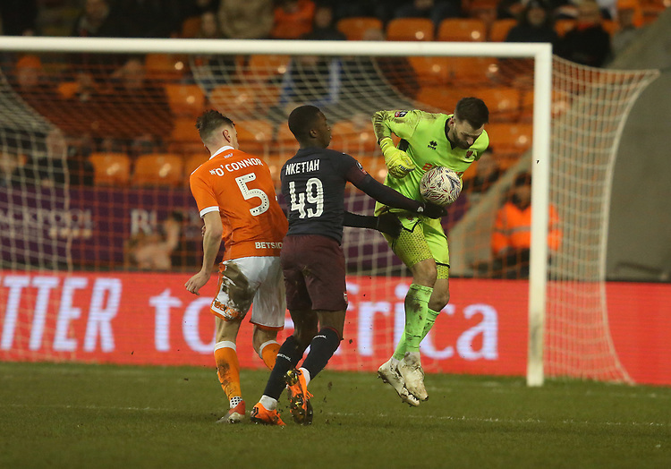 Blackpool's goalkeeper Mark Howard heads clear from Arsenal's Edward Nketiah<br /> <br /> Photographer Stephen White/CameraSport<br /> <br /> Emirates FA Cup Third Round - Blackpool v Arsenal - Saturday 5th January 2019 - Bloomfield Road - Blackpool<br />  <br /> World Copyright &copy; 2019 CameraSport. All rights reserved. 43 Linden Ave. Countesthorpe. Leicester. England. LE8 5PG - Tel: +44 (0) 116 277 4147 - admin@camerasport.com - www.camerasport.com