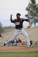 Enyel De Los Santos (21) of the Lake Elsinore Storm pitches against the High Desert Mavericks at The Hanger on August 27, 2016 in Adelanto, California. Lake Elsinore defeated High Desert, 10-8. (Larry Goren/Four Seam Images)