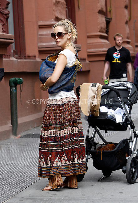 WWW.ACEPIXS.COM . . . . .  ....May 23 2010, New York City....Actress Kate Hudson was seen shopping with friends in the West Village, and seemed to enjoy carrying their baby on May 23 2010 in New York City....Please byline: NANCY RIVERA- ACEPIXS.COM.... *** ***..Ace Pictures, Inc:  ..Tel: 646 769 0430..e-mail: info@acepixs.com..web: http://www.acepixs.com