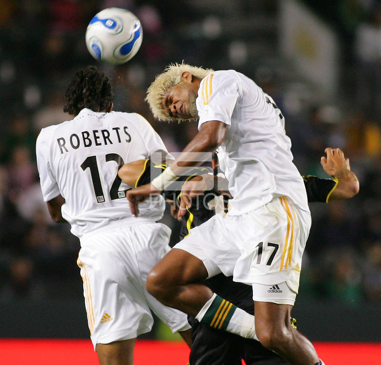 LA Galaxy Defenders Troy Roberts (12-L) and Abel Xavier (17-R) defend against Columbus Crew DEF Stefani Miglioranzi (15) during a MLS match. The Columbus Crew beat the LA Galaxy 3-2 at the Home Depot Center in Carson, California, Saturday, June 23, 2007.