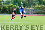 QPR's Tadgh O'Mahony heads the ball out of danger  against Tralee Dynamos in the Greyhound Bar Cup Quarter final in Mounthawk Park on Sunday.