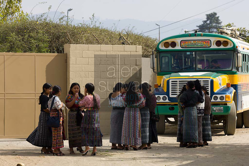 Workers wait for buses during a shift change at Legumex, a vegetable and fruit company that exports to the United States, in Chimaltenango, Guatemala on Thursday, March 8, 2007, a payday. Shifts can run from 12 to 14 hours.
